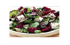 Fresh beetroot salad with feta cheese and vinaigrette dressing over leafy greens (220 Kcal)