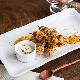 Cajiun chicken with mango salad and yoghurt herbs