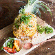 Fried rice with macadamia and pineapple, served in fresh pineapple